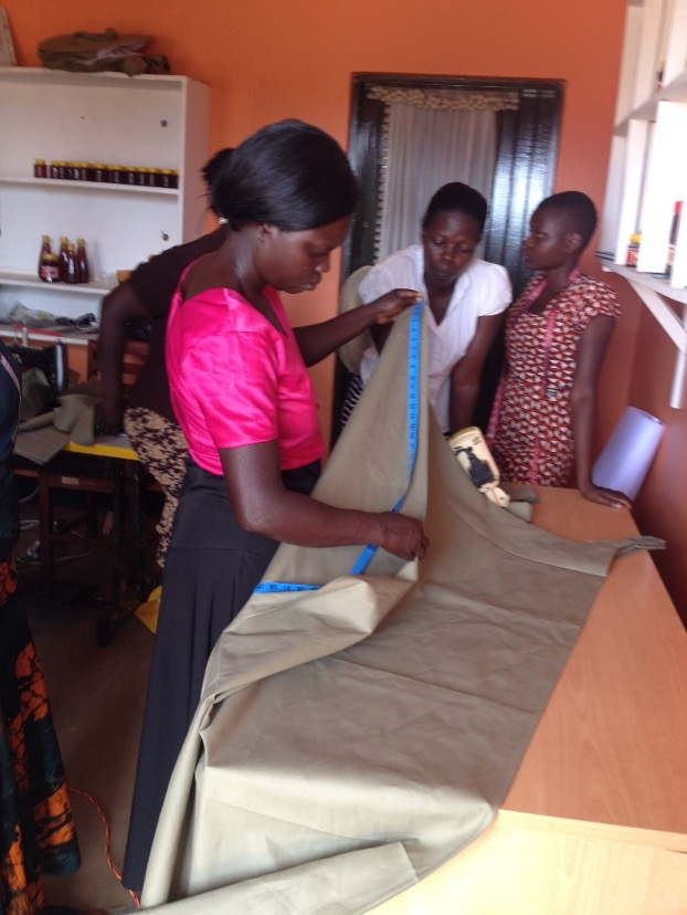 Women at work measuring materials to be cut
