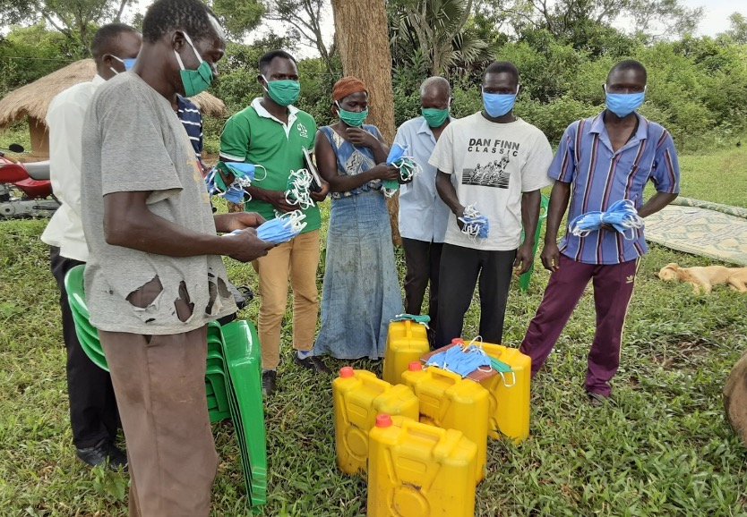 farmers supported with face mask and liquid soap by HIVE Uganda against COVID-19
